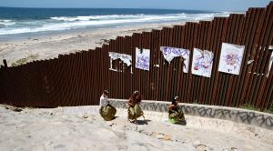 US-Mexico-border-fence-at-beach-in-Tijuana-e1530628968728