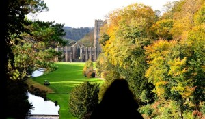 A visitor looks at the view of Fountains Abbey near Ripon, northern England