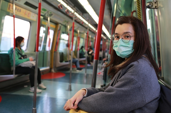 masked girl to protect herself from wuhan virus in public area
