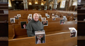 Priest taping photos in worship