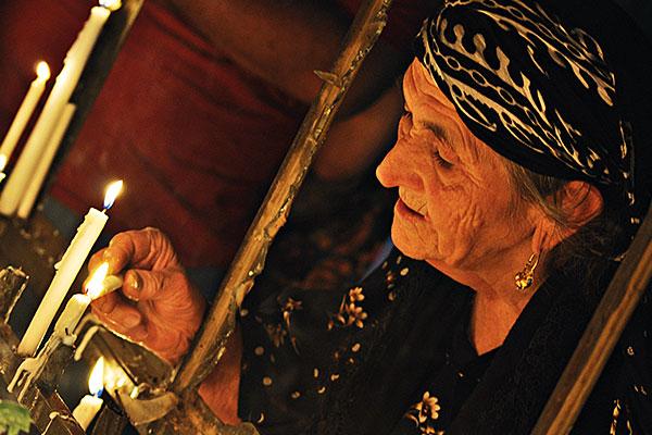 womanlightingcandleembed